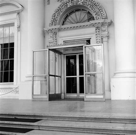 white house door winter door enclosure on the portico f