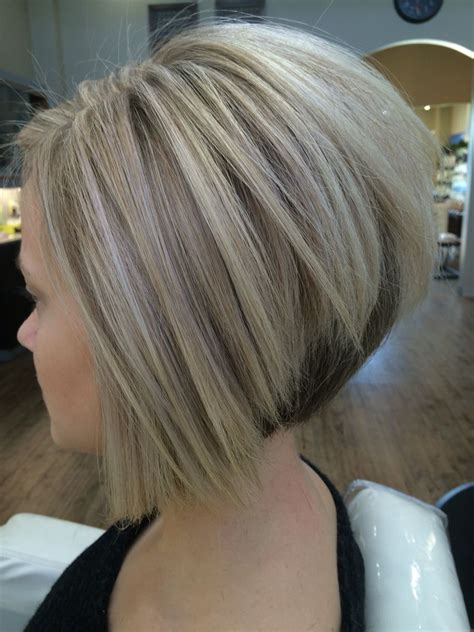cool blonde color  sharp inverted bob  created