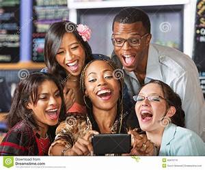 Laughing Students Holding Smartphone Stock Image - Image ...