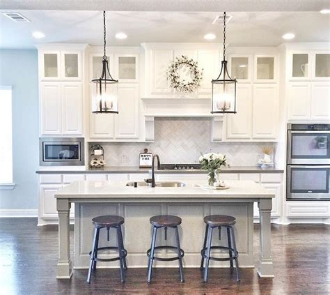 white kitchen with island extend cabinets to ceiling with glass cabinets kitchen