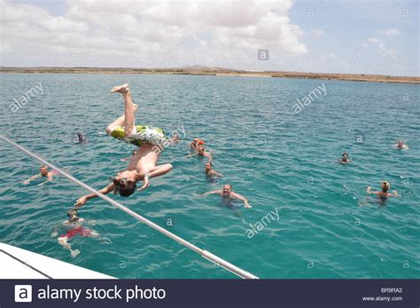 Rock The Boat En Francais by Boy Jumping Boat On Catamaran Boat Trip Coast Of