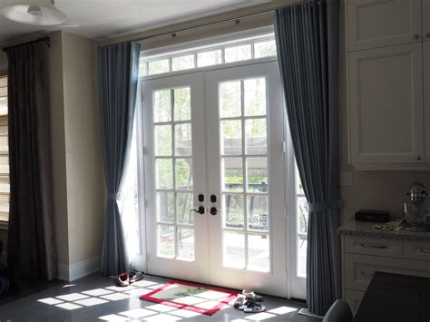 drapes    good solution  cover multiple door glass
