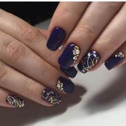 Shaped dark blue nail art design the nails have a