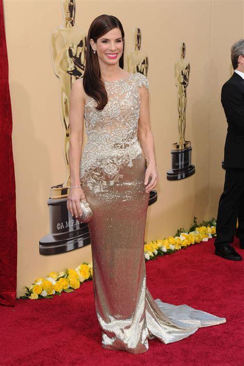 sandra oh red dress designer vera farmiga and sandra bullock in marchesa dresses at the