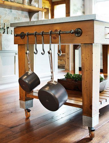 kitchen island with hanging pot rack pot rack on the side of the island kitchen
