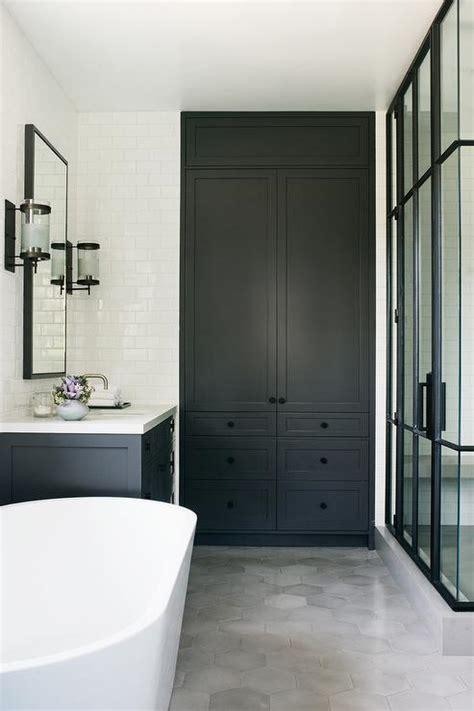 gray black kitchen cabinets  shiny brass knobs