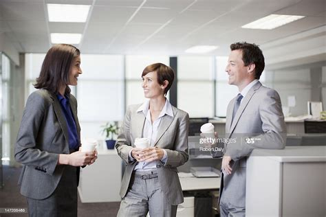 Ensuring each cuppa is the best cuppa. Business People Drinking Coffee And Talking In Office High-Res Stock Photo - Getty Images