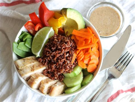 a meal chicken veggie bowl with ginger almond sauce