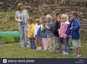 Group of pre school children standing in a line, waiting ...