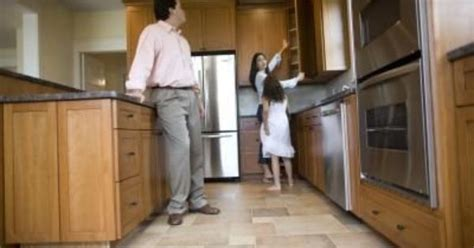 How To Remove Greasy Film From Kitchen Cabinets