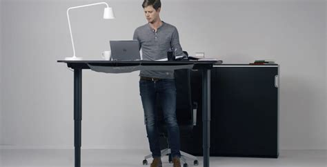 ikea standing desk legs this new ikea desk goes from sit to stand with the push of
