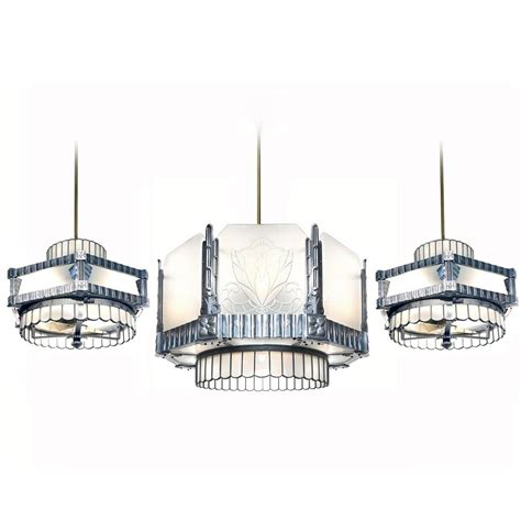 deco theater chandelier and matching ceiling fans at