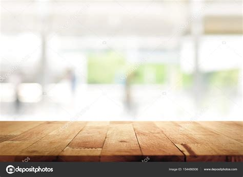 kitchen table background wood table top on blur kitchen window background stock