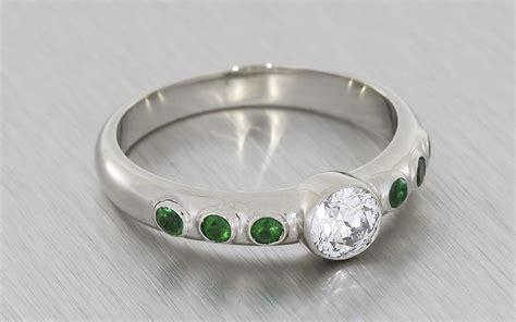contemporary bezel set diamond and emerald engagement