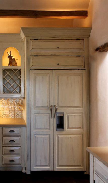 I love the idea of having a wood panel refrigerator door