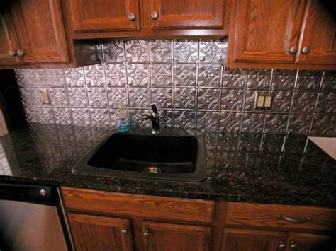 backsplash for kitchen with black granite countertop black granite countertops with tin look backsplash 9702