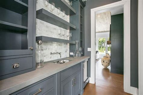 appointed gray butlers pantry features glass front