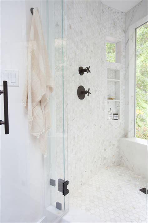 corner bathroom with marble hexagon mosaic tile floor and