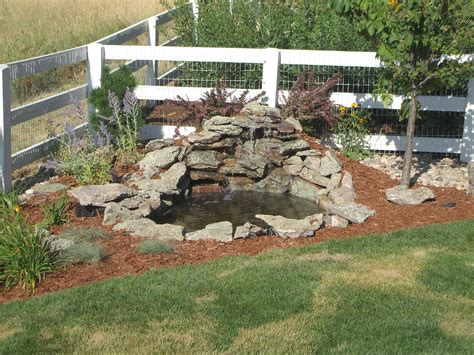 Small Diy Ponds With Waterfall And Stone Border In The