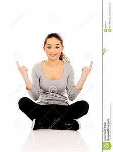 Woman Sitting Cross Legged Pointing Up. Stock Photo ...