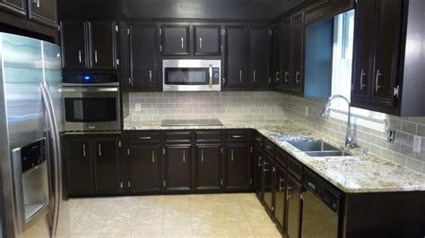 dark cherry cabinet with white backsplash ideas for