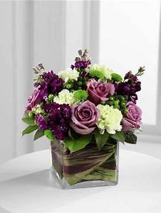 Compact leaf lined vase of purple flowers and green ...