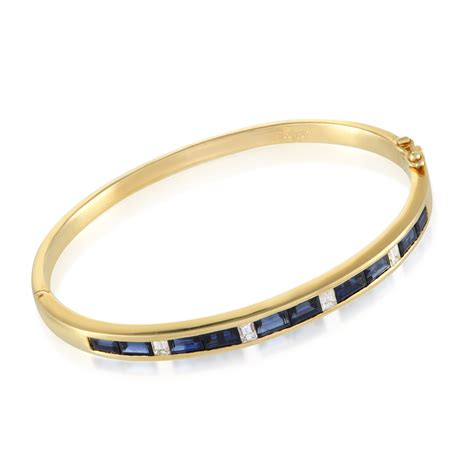 Womens 18k Yellow Gold Diamond And Sapphire Bangle Bracelet. Medieval Wedding Rings. Leverback. Plain Gold Bands. Black And White Rings. Rare Watches. Green Stone Necklace. Baby Girl Lockets. Ceylon Sapphire