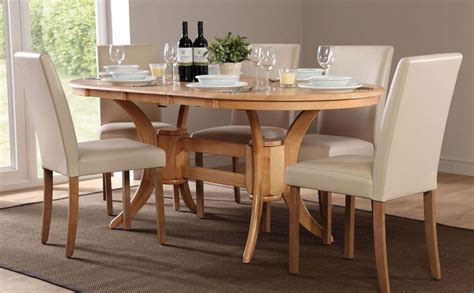 oval dining table and chairs townhouse oval extending dining table 6 chairs and 6