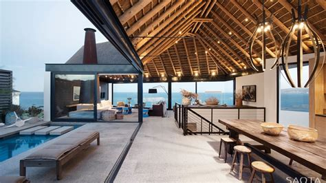 Thatched Roof House With Outdoor Entertaining Spaces by Thatched Roof House With Outdoor Entertaining Spaces