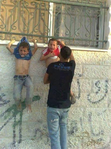 hamas hangs young children  fence    human