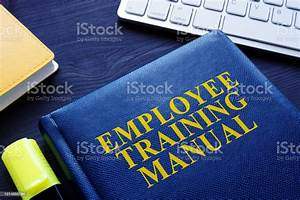 Employee Training Manual On An Office Table Stock Photo