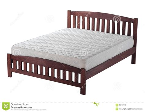 Double Bed With Wooden Headboard Royalty Free Stock Image
