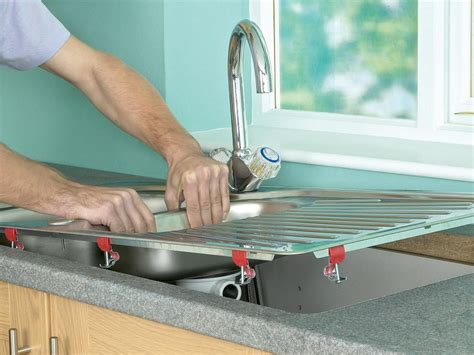 how to install kitchen faucet with undermount sink how to install a kitchen sink in a laminate or wood 9771
