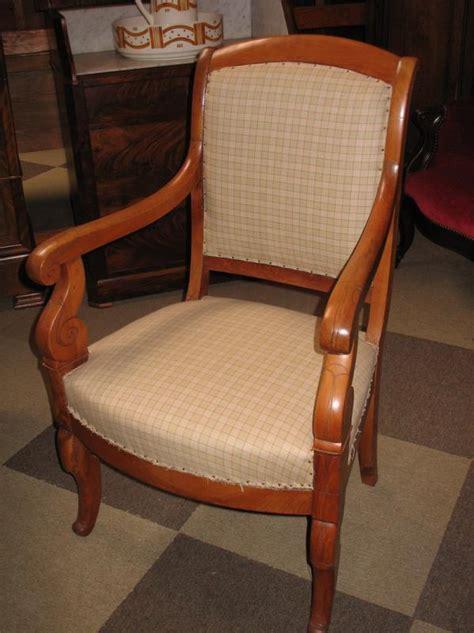 fauteuil restauration en merisier xixe antiquites lecomte