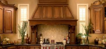 tuscan kitchen backsplash wood hoods kitchen focal points dura supreme cabinetry