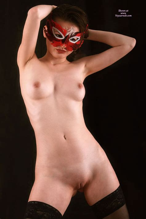 Shaved Asian Girl In Red Feather Mask Standing October Voyeur Web Hall Of Fame