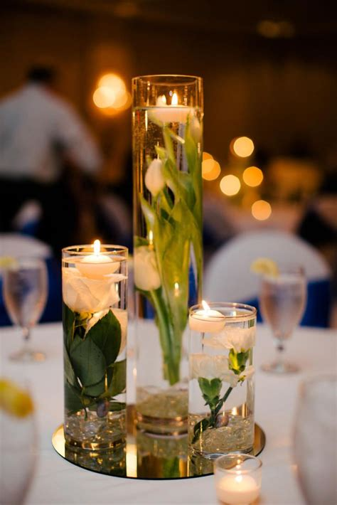 submerged flower centerpieces  floating candles