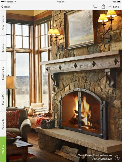 rustic mantle dark trim   farmhouse fireplace