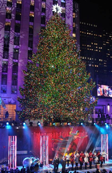 behold rockefeller center tree lights up the