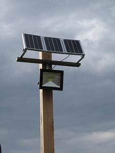 W led flood light with solar panel and internal battery