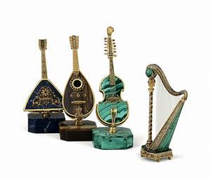 A group of four miniature musical instruments. Milanese ...