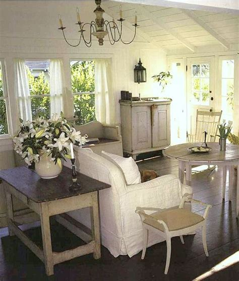 how to decorate country cottage style cape cod cottage style white beachy living room cathedral cielings dark wood floors shabby