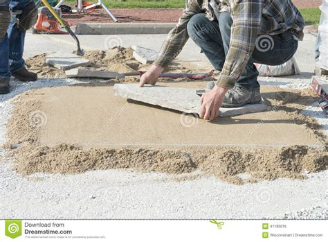 house or home improvement laying patio landscaping