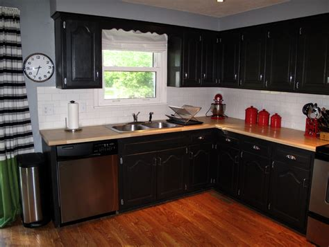 Black Cupboards Kitchen Ideas by Thinking Black Cabinets With Butcher Block Countertops