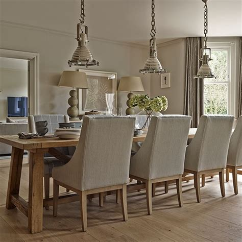 neutral dining room with silver pendant lights explore