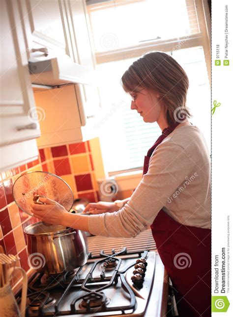 young wife cooking  home stock photo image  informal