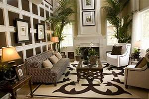 area rugs in living room with brown sofa and brown chairs With design rugs for living room