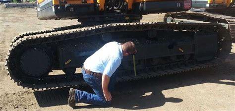 properly adjust  track tension   crawler excavator