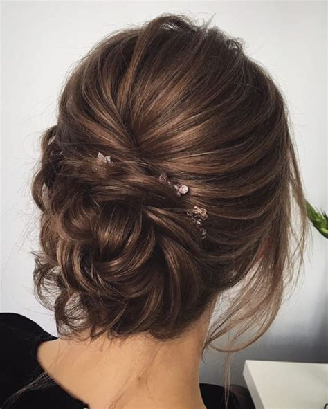 top  messy updo hairstyles  bohemian wedding