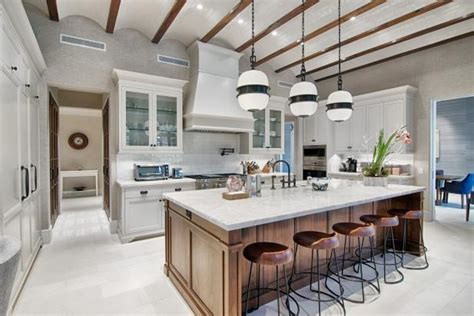 gorgeous gourmet kitchen  wood island  hgtvs